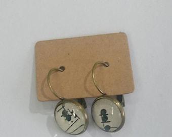 Drop earrings.  Vintage music sheet.