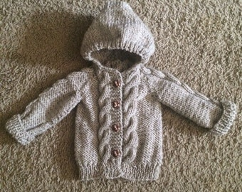 Cable knit baby sweater with monkey buttons made to order