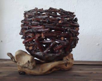 Driftwood, nest on branch, basket, egg cups, brush holders, pen holders