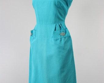 1950s turquoise wiggle dress with rhinestones