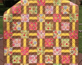 "Flower Power, Polka Dots and Retro Whimsy Are Altogether In This 40"" X 49.5"" Quilt"