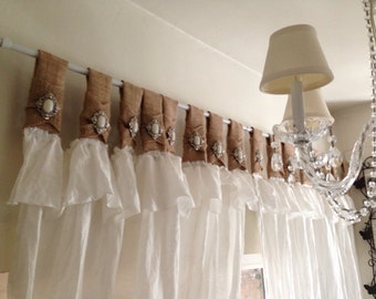 Burlap and white linen curtains with jewelry accent
