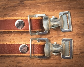 Bicycle pedal strap.  Strap foot bicycle. Vegtanned leather, chrome-plated buckles. Bike components. Cognac Colour.