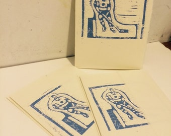 Handmade linocut card--toy stick hockey guy