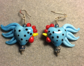 Light blue with black spots heart shaped rooster bead earrings adorned with light blue Czech glass beads.