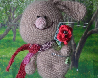 """New! The hare is knitted. """"Bunny with a flower"""". Beige. Toy hare. Rabbit Knitted. Handmade."""