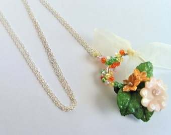Spring flowers necklace cold porcelain and pearls.
