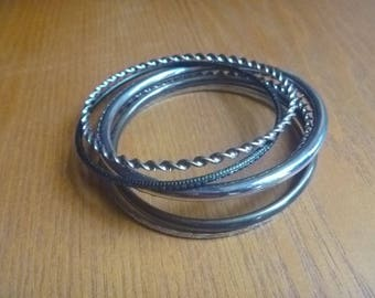 six stacking bangles, silver tone and black vintage stacking bangles