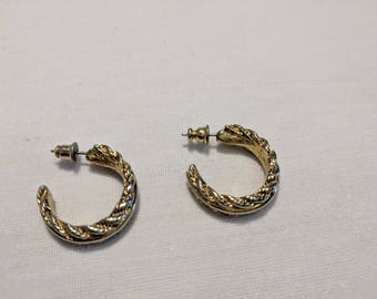 Gold tone small hoop earrings.  Pierced.  No marks.