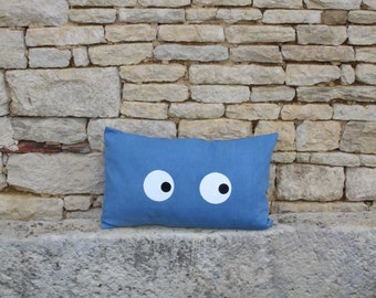 Cushion naturally indigo dyed and painted eyes