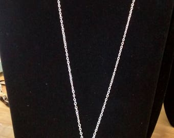 Silver swirls necklace and earring set.