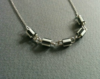 Circus. Recycled plastic and stainless steel necklace.