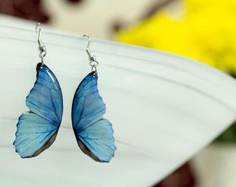 Blue morpho small butterfly wing earrings looks like real butterfly. Comes in a gift box.