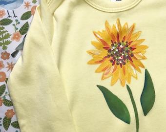 Sunflower Gender Neutral baby bodysuit, hand painted organic cotton that is machine washable.