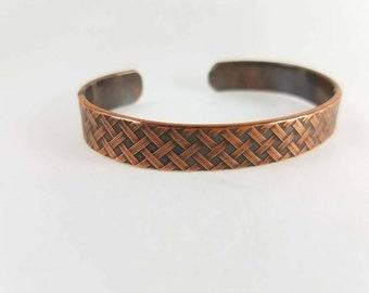 Copper cuff bracelet with basket weave pattern