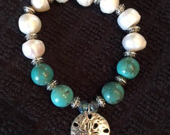 Pearls and Turquoise Elastic Bracelet with a Sand Dollar Charm