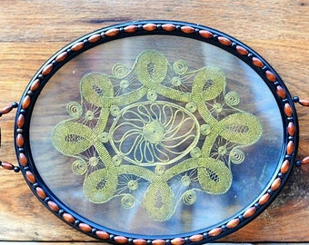 Old tray with glass and inlaid lace