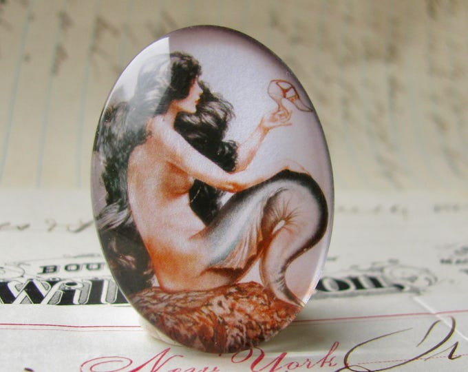 Mermaid holding a shoe, wishing for legs, long black hair, handmade glass oval cabochon, 40x30 or 25x18, from our Magical Maidens collection