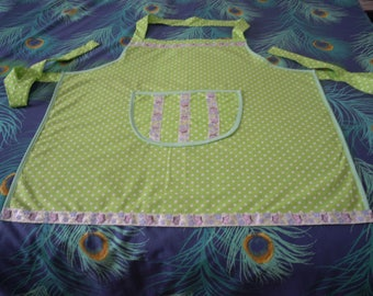 fancy apron of cooking green with white dots