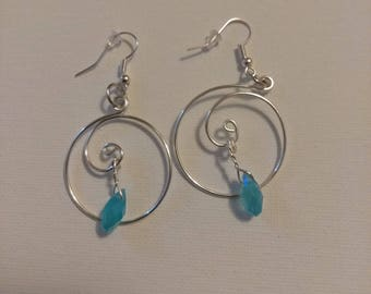 Wire spiral earrings with light blue charm