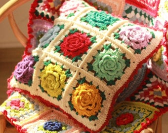 Gorgeous traditional style hand crocheted granny squares cushion in a raised flower design