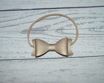 Gold or black leather bow