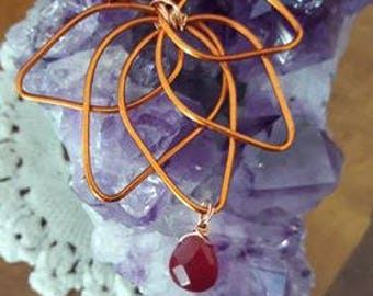 Lotus Pendant in copper and crystal.