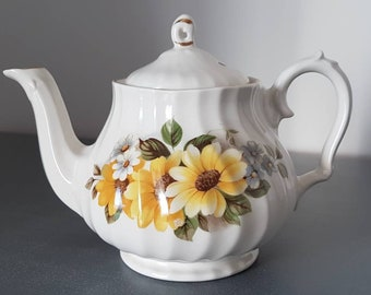 A vintage Sadler small teapot in yellow flower design with daisies and foliage. A lovely housewarming gift.