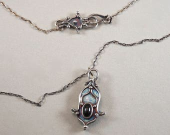 Wish.  Clear and centered Black star diopside and Sterling Silver Necklace.  Ornate, arabesque pendant.  One of a kind.  Handmade.