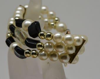 Gold tone faux pearl bracelet