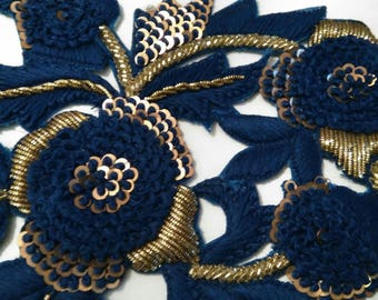 blue embroidered flower applique and gold thread