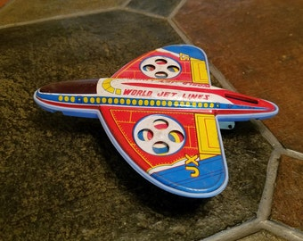 Vintage tin and plastic friction World Jet Lines JX 57 airplane
