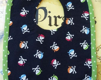 "Original baby ""Pirate seed"" in 100% cotton fabric bib black background, green border"