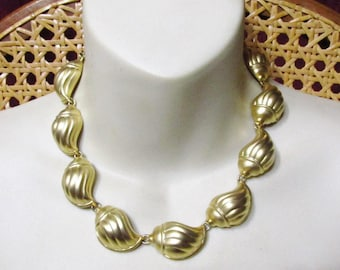 Vintage 1960s frosted gold colored metal deep seashells charm collar necklace.