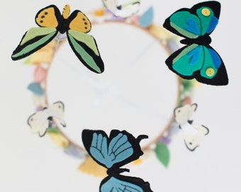 Deluxe butterfly and spring flowers mobile in soft pastels such as blush pink, pale yellow and pale blue and green. Gender neutral.