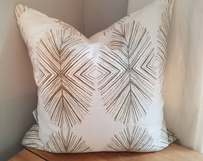 Cream and brown pillow