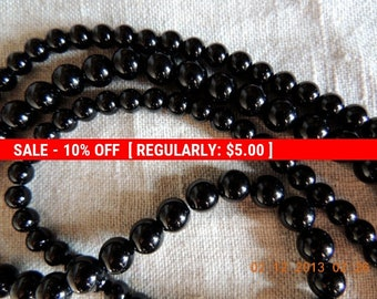 Black Obsidian 50X8 mm beads. Free stringing wire. Make your own necklaces, bracelets, Malas, earrings, etc.