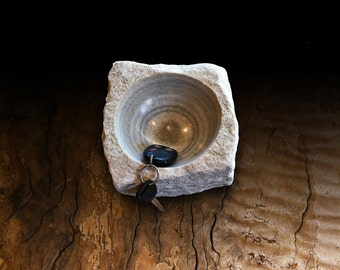 Lime stone natural shaped bowl with beautiful lines.