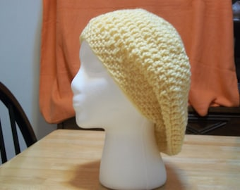 Slouchy hat available in gray, olive, pink, and yellow