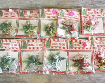 Lot of 10 Vintage Plastic Christmas Package Tie-ons. Mr & Mrs. Clause and Greenery.