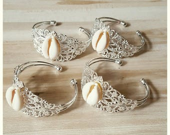 Filigree bracelet with cowrie shells
