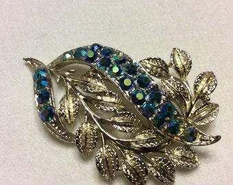 Vintage 1950's silver leaf blue aurora borealis rhinestones rhodium brooch pin.