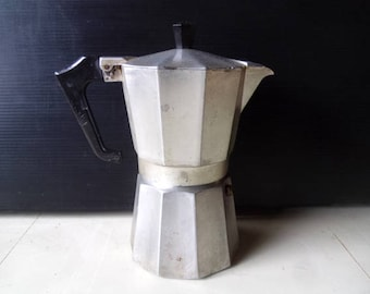 Classic Italian coffee maker. Vintage aluminium espresso filter coffee pot. Stovetop moka pot. Macchinetta Italian kitchenware