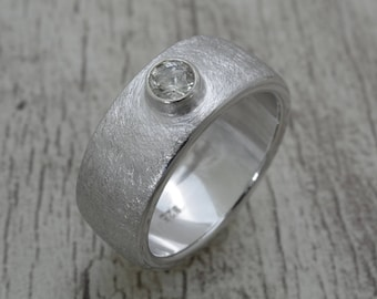 Silver ring with topaz stone