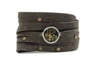 Shi Bandit Cuff: Gray Leather Wrap Cuff with Brass Studs and Silk Charm