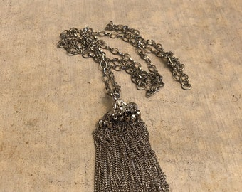 Silver chain with metal tassel