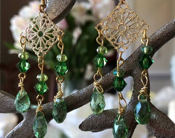 Chandelier gold filigree earrings with green crystal bicones.
