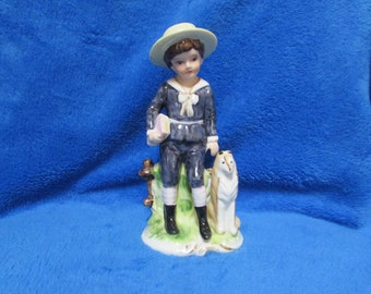 Vintage boy with dog porcelain figurine