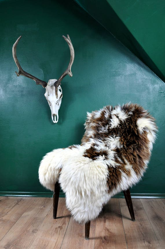 Very ORIGINAL sheepskin rug!!! Great long and soft hair!!! Untipical design!! About 135cm long!!!