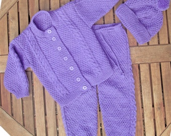 Baby infant girl toddler hand knitted mauve traditional matinee outfit of jacket / cardigan trousers / legging pants pom pom hat pram set.